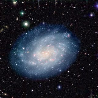 Colour-composite image of the nearby spiral galaxy NGC 300 and the surrounding sky field, obtained in 1999 and 2000 with the Wide-Field Imager (WFI) on the MPG/ESO 2.2-m telescope at the La Silla Observatory.